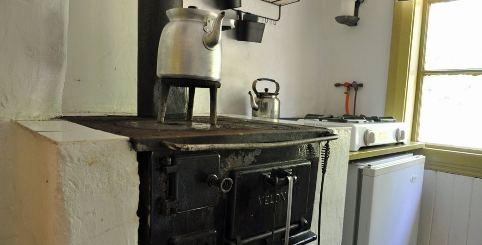 Woodheated kitchenstove and refrigerator